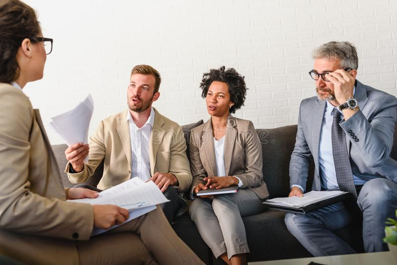Diverse business team discussing work in their office royalty free stock images