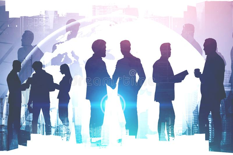 Diverse business team, international partnership. Diverse business team working together over cityscape background with double exposure of planet hologram royalty free stock photo