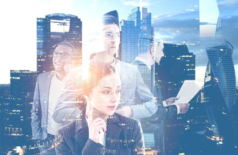 Diverse business team in modern city. Portrait of diverse business team leaders working together over modern cityscape background. Toned image double exposure stock image