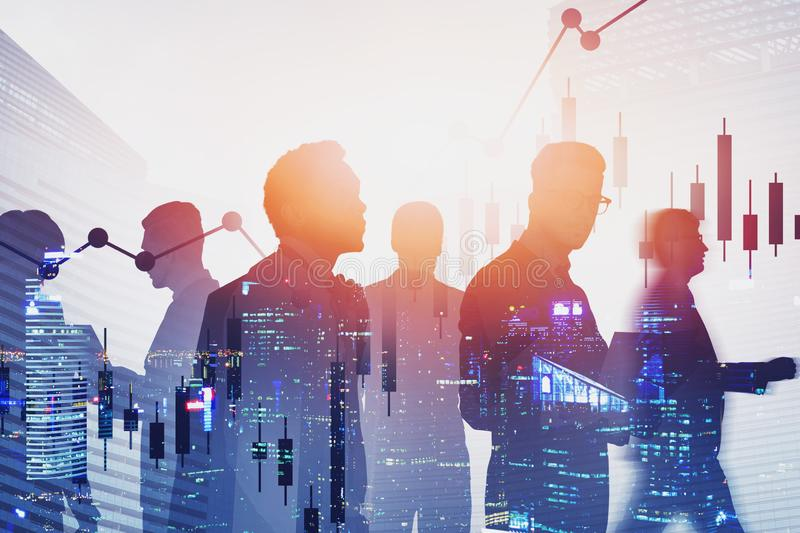 Diverse business team in night city, graphs stock photos