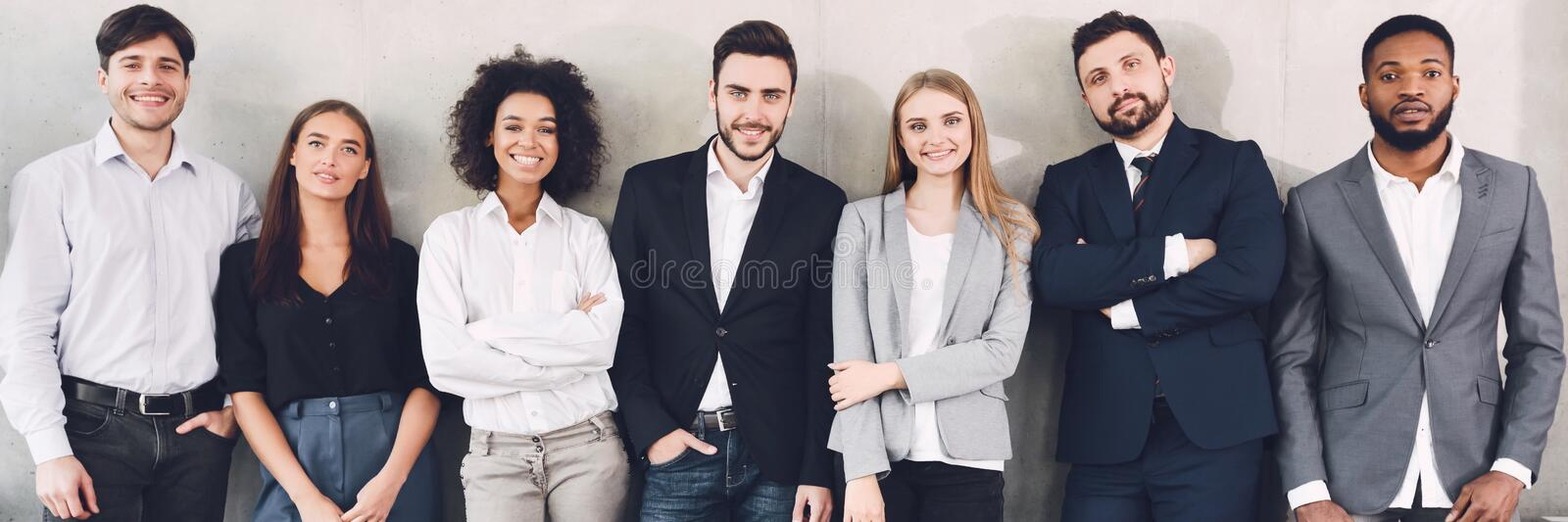 Diverse business team smiling to camera in office stock image