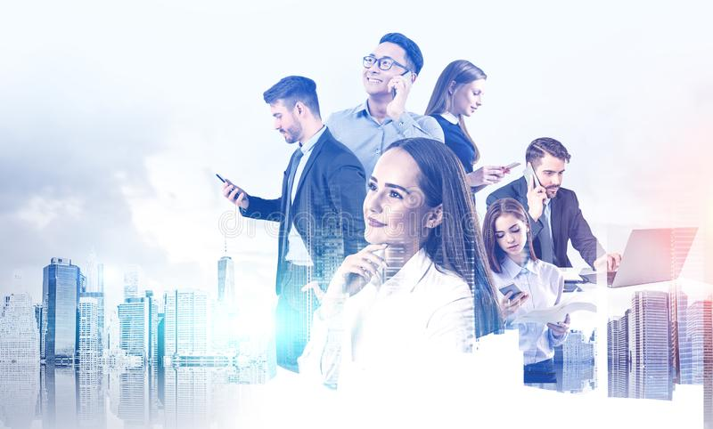 Diverse business team using gadgets stock images