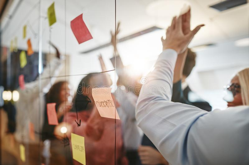 Diverse businesspeople high fiving after brainstorming together royalty free stock photo