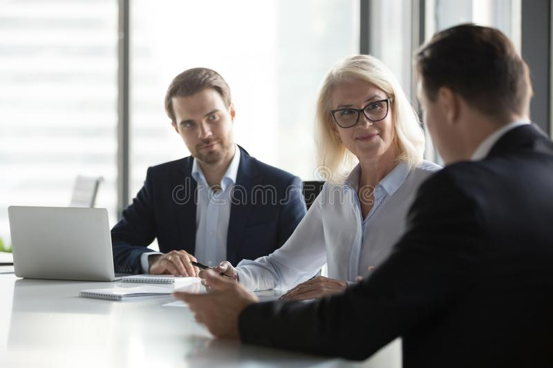 Diverse businesspeople negotiate at business meeting in office stock photo