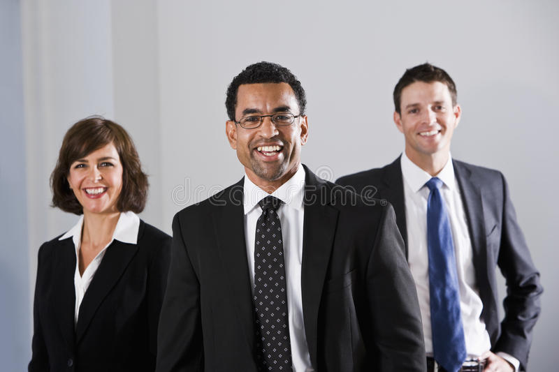Diverse businesspeople in suits stock images