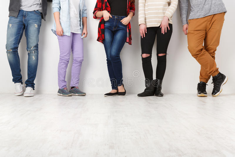 Diverse casual people standing in row indoor, crop royalty free stock images
