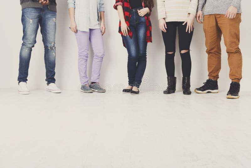 Diverse casual people standing in row indoor, crop stock image