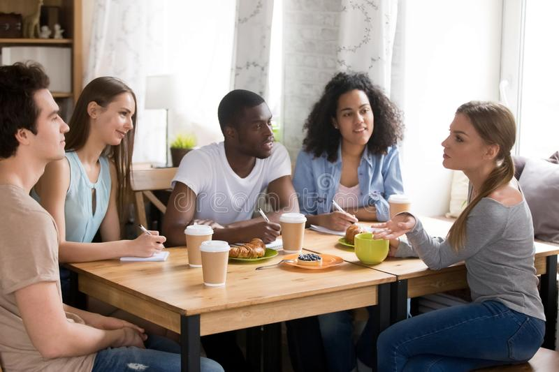 Diverse cheerful students preparing together for exam. stock image