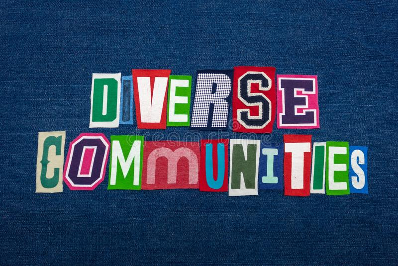 DIVERSE COMMUNITIES text word collage, multi colored fabric on blue denim, community diversity concept. Horizontal aspect stock photos