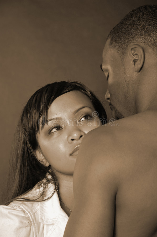Diverse couple. Asian female and african american male hugging in sepia