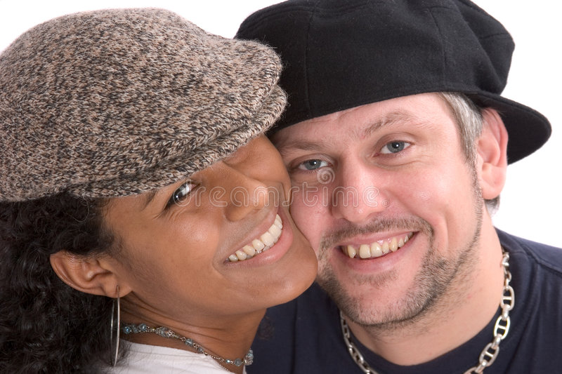 Diverse couple with hats stock photography