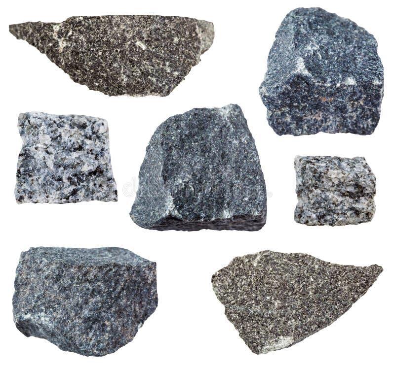 Diverse die Gabbro rotsen op wit worden geïsoleerd stock afbeelding