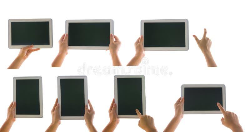 Diverse die tabletcomputer in een hand op witte backgrou wordt geïsoleerd stock afbeeldingen