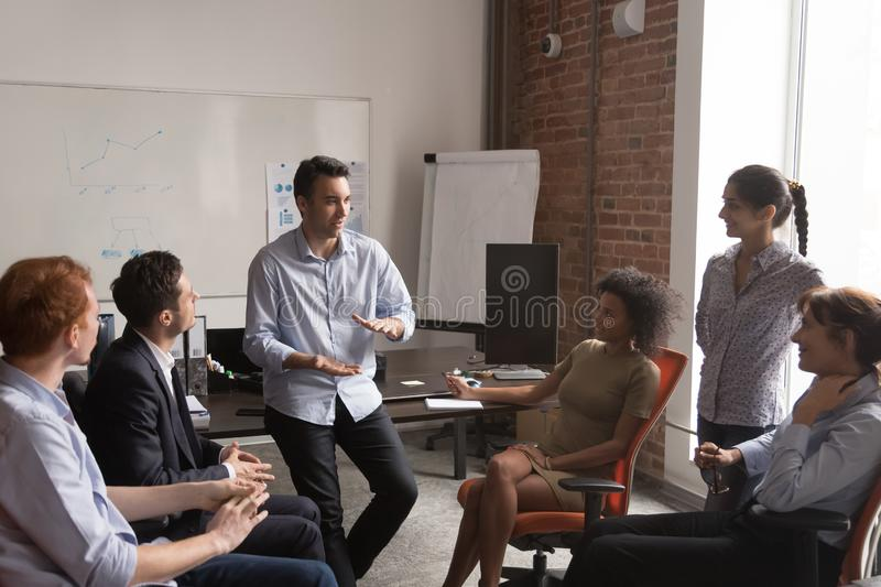 Diverse employees brainstorm sharing ideas at office meeting stock images