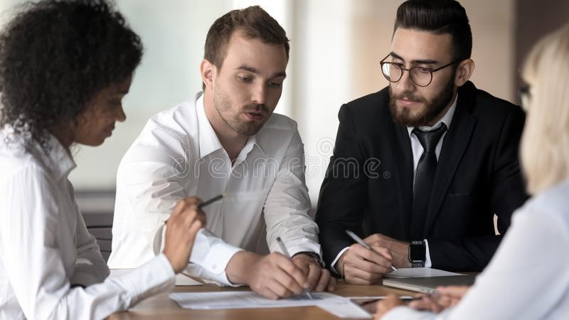Diverse employees group working on project, discussing business strategy royalty free stock photography