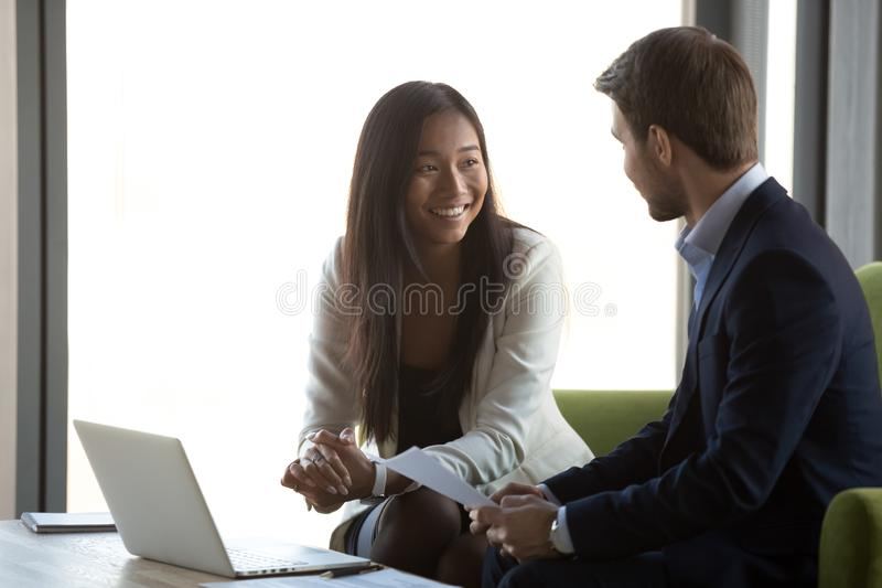 Diverse financial advisor and client having conversation at business meeting stock images