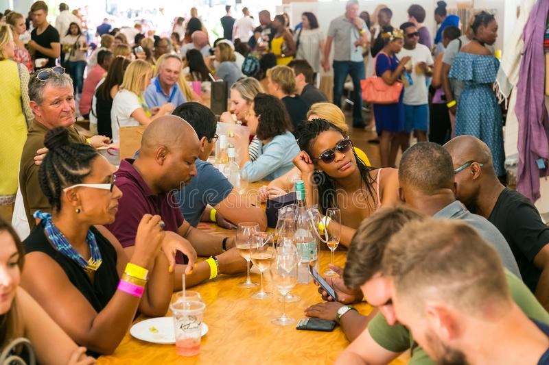 Diverse Friends eating, drinking and generally enjoying a day out at a Food and Wine Fair. Johannesburg, South Africa - October 15 2016: Diverse Friends eating royalty free stock photos