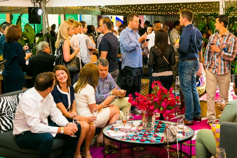 Diverse Friends eating, drinking and generally enjoying a day out at a Food and Wine Fair. Johannesburg, South Africa - October 13 2016: Diverse Friends eating royalty free stock photography