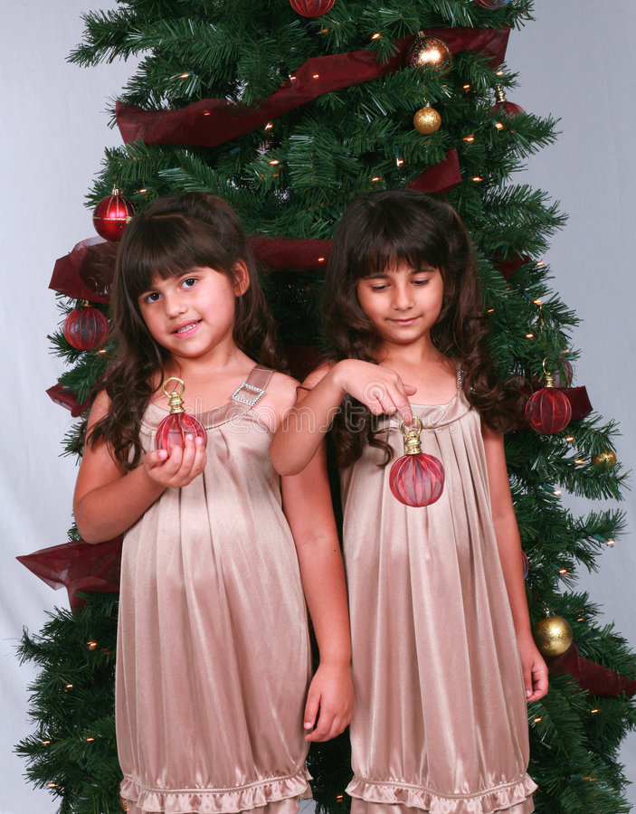 Diverse girls with christmas ornaments stock photography