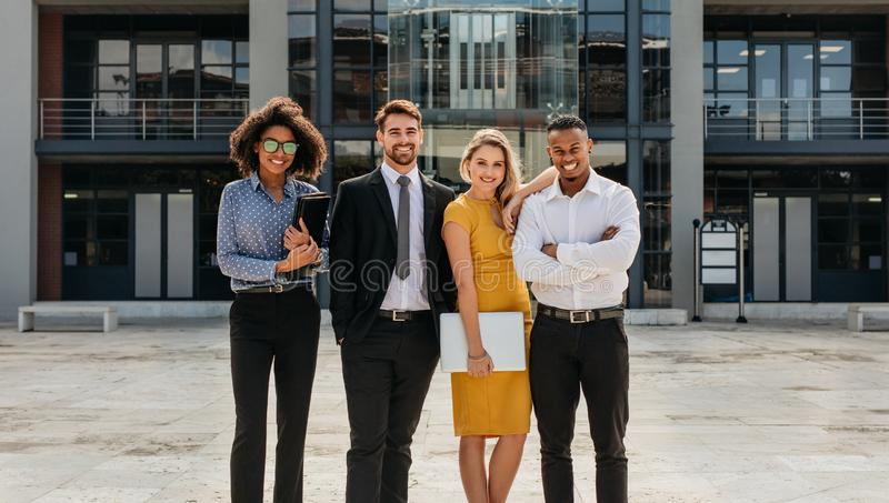 Diverse group of business professionals standing outdoors royalty free stock photo