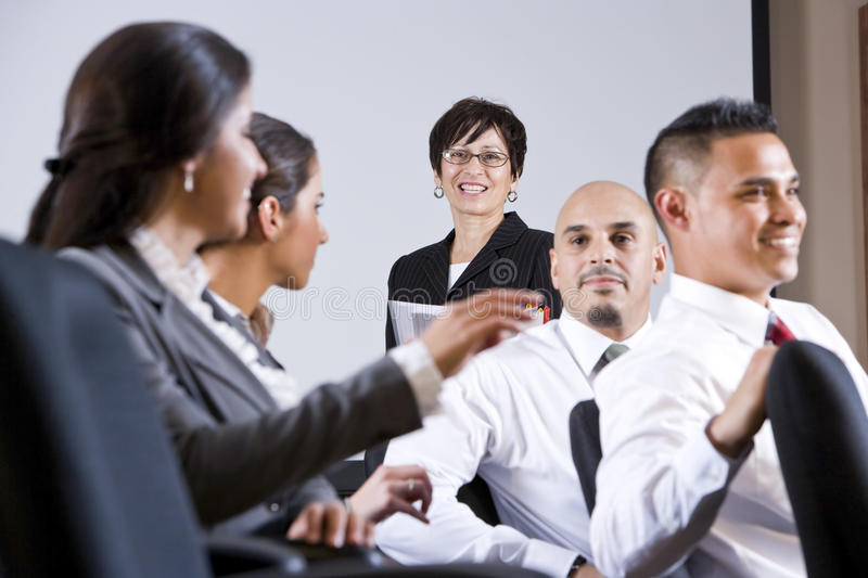 Diverse group businesspeople watching presentation stock images