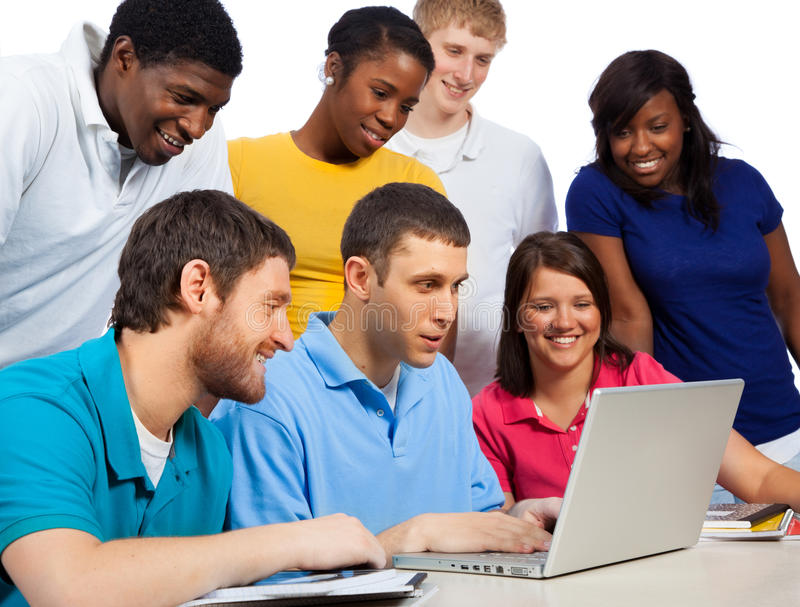 Diverse group of college students/friends looking at a computer royalty free stock photo