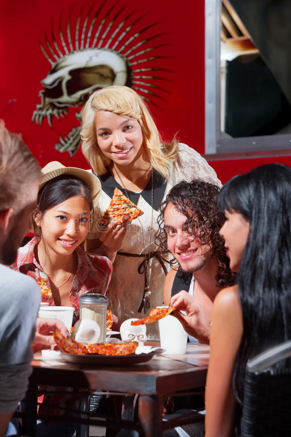 Free Diverse Group Eating Pizza Outside Stock Images - 29584394