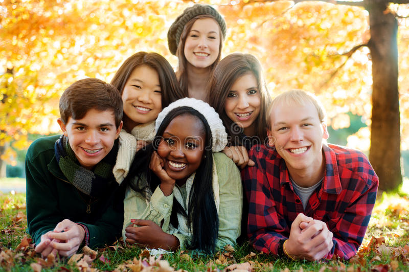 Diverse group of friends in a pyramid stock image