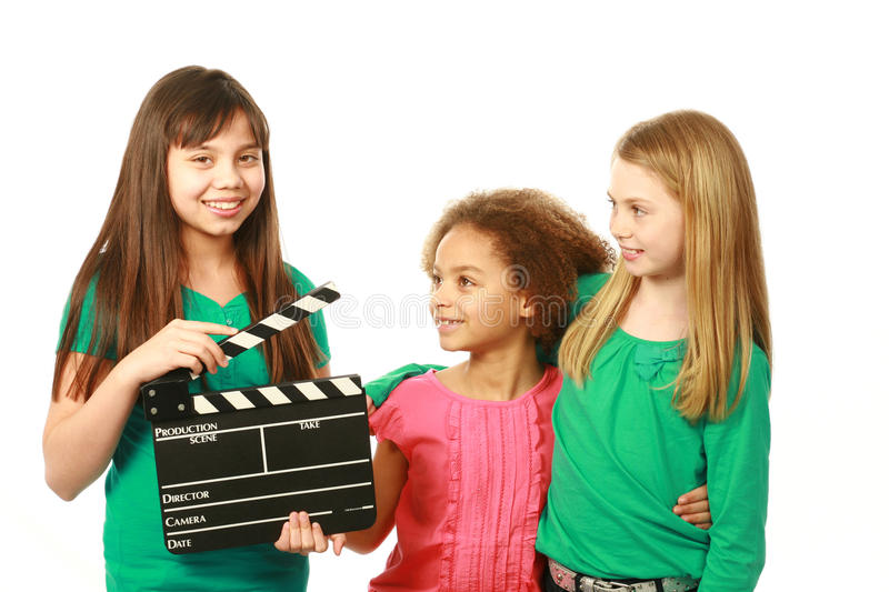 Diverse group of girl actors. Diverse group of girls with one holding film slate royalty free stock images
