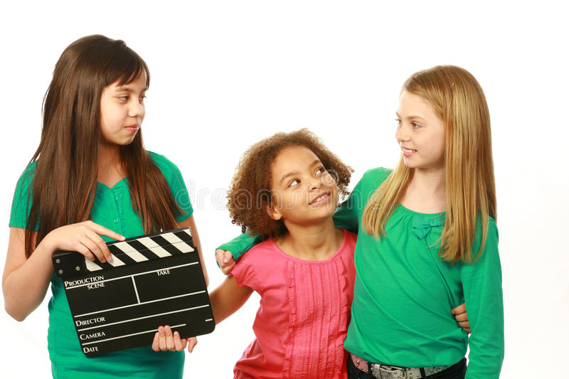 Diverse group of girl actors. Diverse group of girls with one holding film slate royalty free stock photography