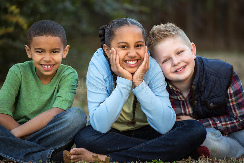 Diverse group of kids outside at a park. royalty free stock photo