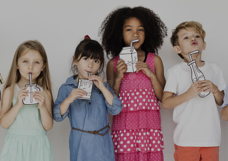 Diverse group of kids standing in a row portrait stock images