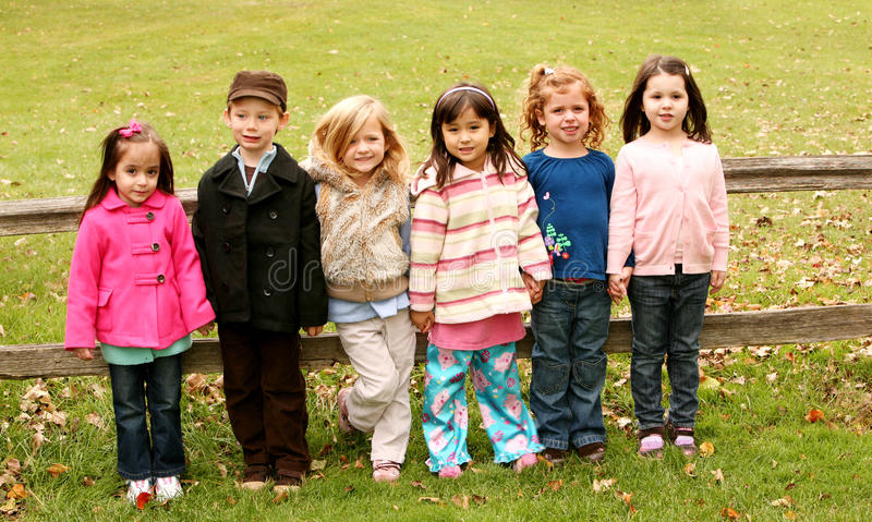 Diverse group of little kids outside