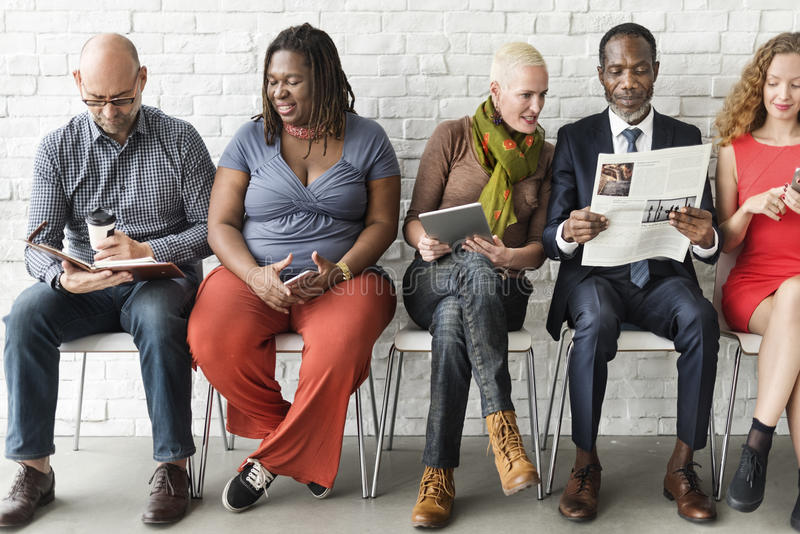Diverse Group of People Community Togetherness Technology Sitting Concept royalty free stock photo
