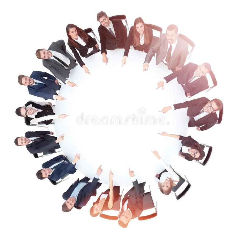 Diverse group pf young business people seated round a table disc royalty free stock image