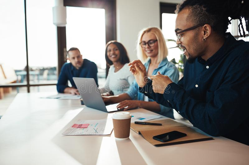 Diverse group of smiling office colleagues talking together at w royalty free stock image