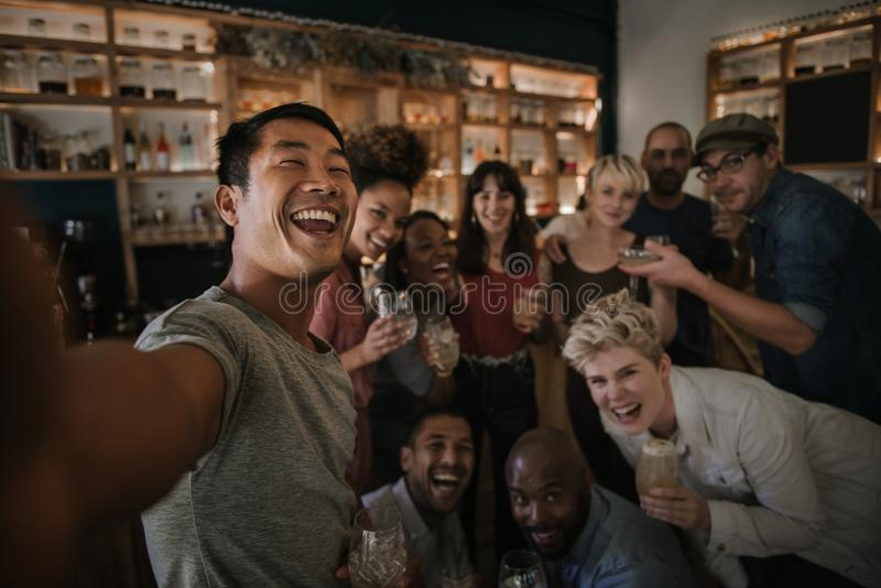 Friends having fun and taking selfies in a bar royalty free stock photos