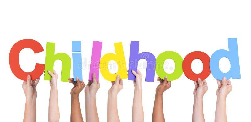 Diverse Handen die de Word Kinderjaren houden royalty-vrije stock fotografie