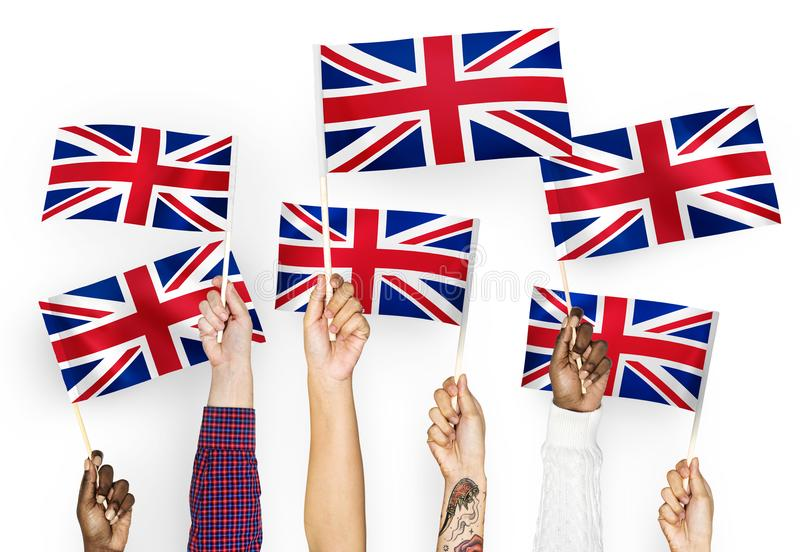 Diverse hands waving the Union Jack flags stock images