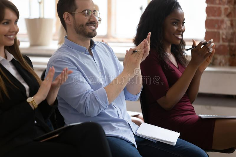 Diverse happy business team audience group applauding sit on chairs. Diverse happy business team audience people listeners group applauding sit on chairs royalty free stock photos