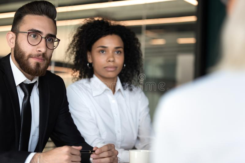 Diverse hr managers listening to job applicant during interview royalty free stock images