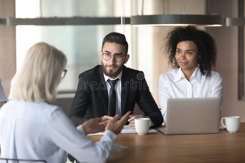 Diverse hr managers listening to mature businesswoman job applicant stock photos