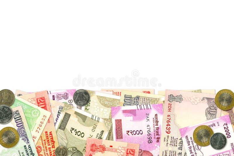 Diverse Indische bankbiljetten en muntstukken die Indische economie illustreren royalty-vrije stock foto