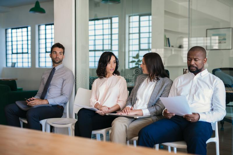 Diverse job applicants waiting for their job interviews royalty free stock photo