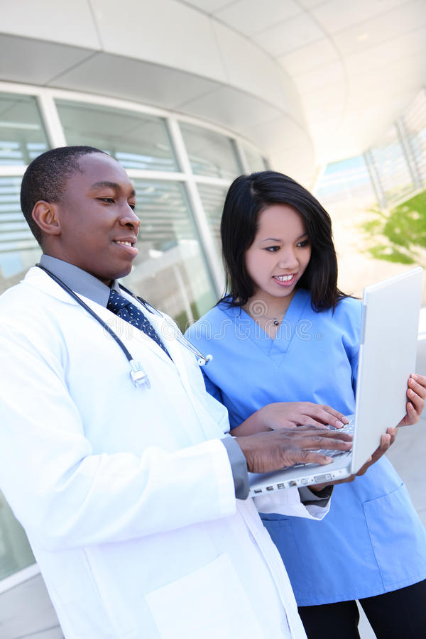 Download Diverse Medical Team At Hospital Stock Photo - Image of case, friendly: 15178880