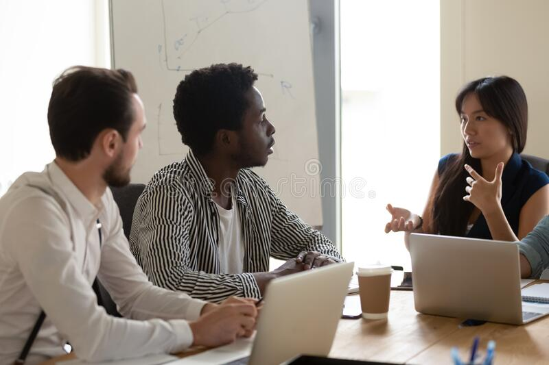 Multiethnic diverse employees brainstorm at meeting in office royalty free stock image