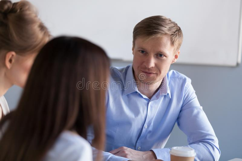Diverse millennial colleagues have talk during office break stock photos