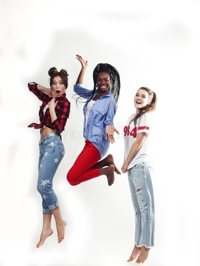Diverse multi nation girls group, teenage friends company cheerful having fun, happy smiling, cute posing isolated on stock photo
