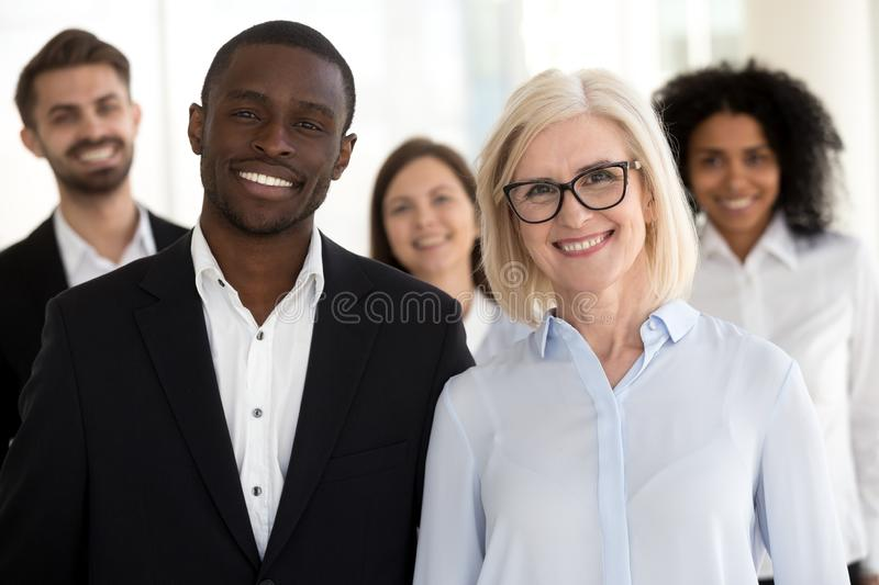Diverse old and young professional business coaches with team pe stock images