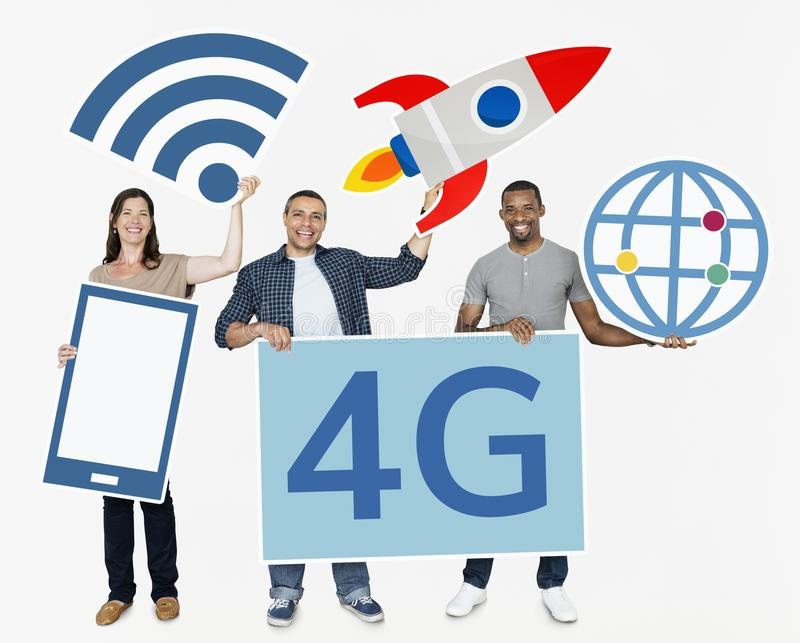 Diverse people holding technological icons stock images